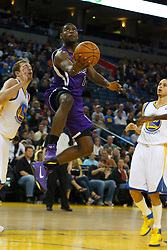 April 10, 2011; Oakland, CA, USA;  Sacramento Kings point guard Tyreke Evans (13) shoots against the Golden State Warriors during the first quarter at Oracle Arena.