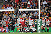 Crusaders look on while Quade Cooper nails home the winning penalty goal for the Reds ~ Super 15 rugby (Round 15) - Reds v Crusaders played at Suncorp Stadium, Brisbane, Australia on Sunday 29th May 2011 ~ Photo : Steven Hight (AURA Images) / Photosport