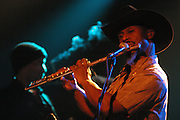 Karl Denson plays flute during a performance with his Karl Denson's Tiny Universe band at the Cabooze, Dec. 12, 2004, in Minneapolis, MN. (Charles Hall/challphotos.com)