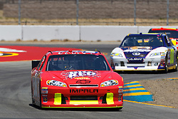 June 24, 2011; Sonoma, CA, USA;  NASCAR Sprint Cup Series driver Dave Blaney (36) leads driver David Reutimann (00) through turn 7 during practice for the Toyota/Save Mart 350 at Infineon Raceway.