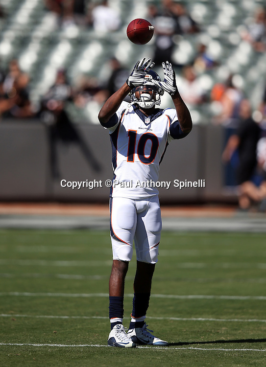 Denver Broncos wide receiver Emmanuel Sanders (10) catches a pass while warming up before the 2015 NFL week 5 regular season football game against the Oakland Raiders on Sunday, Oct. 11, 2015 in Oakland, Calif. The Broncos won the game 16-10. (©Paul Anthony Spinelli)