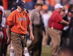 Virginia Football head coach Al Groh leaves the field after losing to Ralph Friedgen (background) at home, 28-26.