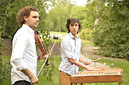 Old Westbury, New York, U.S. - June 21, 2014 - JESSE KOTANSKY, playing violin, and MAX ZBIRAL-TELLER, playing hammered dulcimer, perform live music during Lori Belilove & The Isadora Duncan Dance Company dances during the Midsummer Night event at the historic Long Island Gold Coast estate of Old Westbury Gardens on the first day of summer, the summer solstice.