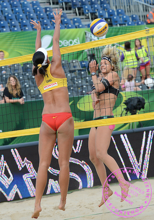 STARE JABLONKI POLAND - July 5:  Chen Xue of China and Laura Ludwig of Germany in action during Day 5 of the FIVB Beach Volleyball World Championships on July 5, 2013 in Stare Jablonki Poland.  (Photo by Piotr Hawalej)