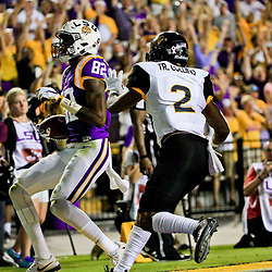 Oct 15, 2016; Baton Rouge, LA, USA;  LSU Tigers wide receiver D.J. Chark (82) runs past Southern Miss Golden Eagles defensive back Trae Collins (2) for a touchdown during the first quarter of a game at Tiger Stadium. Mandatory Credit: Derick E. Hingle-USA TODAY Sports
