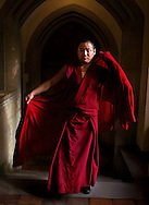 Ngawang Jigdal was born June 1, 1973. During his childhood, he always wished to become a monk. In 1985 he became a monk and studied the elementary texts at his native place for two years. His parents had a great wish to send him to one of three great seats of Buddhist Learning in order to give him a good and traditional monastic education. As a result, in 1987, he joined Drepung Gomang Monastery in South India to pursue traditional monastic studies. Since then he has been studying Buddhist Philosophy. He is very skilled in playing the dunchen (big religious horn) and the Tibetan Yak Dance. He is highly trained in the making of beautiful decorated butter sculptures and is a master in the creation of the Sand Mandala. In addition, he is very well-versed with Buddhist religious chants and rituals.    (Photo by Robert Falcetti). .