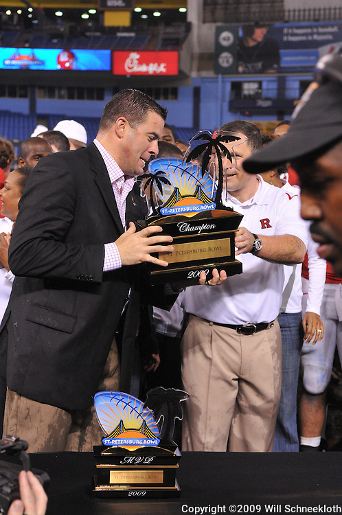 Dec 20, 2009; St. Petersburg, Fla., USA; Rutgers athletic director Tim Pernetti holds the champion's trophy following Rutgers' 45-24 victory over Central Florida in the St. Petersburg Bowl at Tropicana Field.