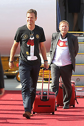 15.07.2014, Flughafen, Muenchen, GER, FIFA WM, Empfang der Weltmeister in Deutschland, Finale, im Bild Manager Oliver Bierhoff (Deutschland) kommt aus der Machiene // during Celebration of Team Germany for Champion of the FIFA Worldcup Brazil 2014 at the Flughafen in Muenchen, Germany on 2014/07/15. EXPA Pictures © 2014, PhotoCredit: EXPA/ Eibner-Pressefoto/ Kolbert  *****ATTENTION - OUT of GER*****