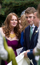 © London News Pictures. 14/09/2013.  Euan Blair and his sister Kathryn Blair after the wedding. The wedding of Euan Blair, Son of former British Prime Minister Tony Blair,  to Suzanne Ashman at All Saints Parish Church in Wotton Underwood, Buckinghamshire. The wedding was attended by Former British Prime minister Tony Blair and his wife Cherie Blair. Photo credit: Ben Cawthra/LNP