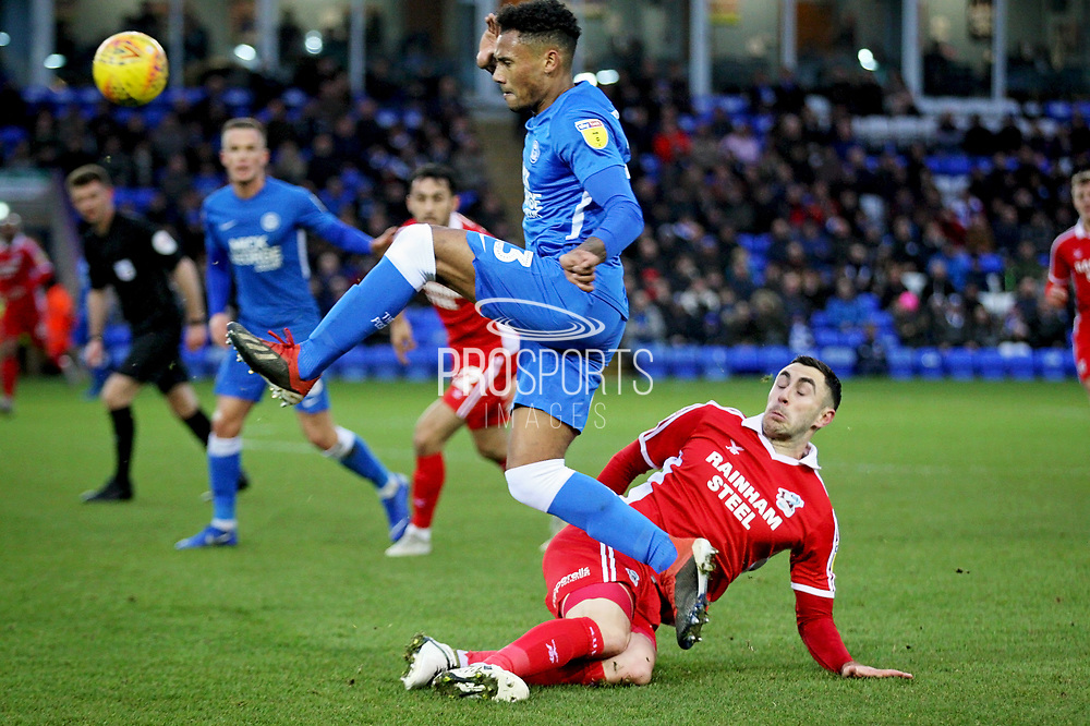Peterborough Utd defender Tyler Denton (23) skips over this challenge during the EFL Sky Bet League 1 match between Peterborough United and Scunthorpe United at London Road, Peterborough, England on 1 January 2019.