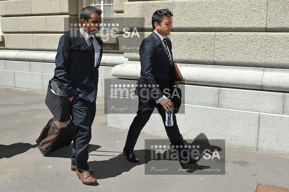 CAPE TOWN, SOUTH AFRICA - Tuesday 14 October 2014, Preyen Dewani (right) and his brother, leave the court during Day 5 of the Shrien Dewani trial at the Western Cape High Court before Judge Jeanette Traverso. Dewani is caused of hiring hit men to murder his wife, Anni. Anni Ninna Dewani (n&eacute;e Hindocha; 12 March 1982 &ndash; 13 November 2010) was a Swedish woman who, while on her honeymoon in South Africa, was kidnapped and then murdered in Gugulethu township near Cape Town on 13 November 2010 (wikipedia).<br /> Photo by Roger Sedres