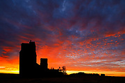 Grain elevators at sunrise in ghost town, Lepine, Saskatchewan, Canada<br /> Lepine<br /> Saskatchewan<br /> Canada