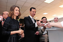 File photo - Syrian president Bashar Al Assad and wife Asma (left) seen voting for the parliamentary elections in a polling station in Damascus, Syria on April 13, 2016. Syria's British-born first lady Asma Assad has begun treatment for breast cancer. The Syrian presidency posted on its Facebook page a photo of President Bashar Assad sitting next to his wife in a hospital room. Photo by Balkis Press/ABACAPRESS.COM