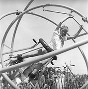 Girl riding gyroscope, Glastonbury, Somerset, 1989