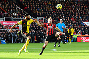 Ryan Fraser (24) of AFC Bournemouth stretches for the ball with Adrian Mariappa (6) of Watford close by during the Premier League match between Bournemouth and Watford at the Vitality Stadium, Bournemouth, England on 12 January 2020.