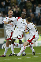 Photo: Marc Atkins.<br />Milton Keynes Dons v Notts County. Coca Cola League 2. 02/09/2006. Lloyd Dyer (C) of MK Dons celebrates with team mates after scoring.