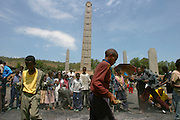 AXUM, TIGRAY/ETHIOPIA..Steles (obelisques) marking Kings' graves at the former Capital. Locals searching the remnants of the meskal festival pire for burning pieces to take home for good luck..(Photo by Heimo Aga)