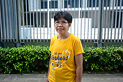 """Phobsuk """"Dang"""" Gasing, a migrant domestic worker and migrant workers' rights activist, plays a leading role in organising an annual rally demanding better conditions for Hong Kong's migrant domestic workforce, as they march to the Central Government Offices in Admiralty, Hong Kong SAR on December 16, 2018. Gasing has been a domestic worker for 27 years and is also an executive committee member of the International Domestic Workers Federation (IDWF) and chairperson of the Hong Kong Federation of Asian Domestic Workers Unions (FADWU) and Thai Migrant Workers Union (TMWU).<br /> Photo by Suzanne Lee/PANOS Pictures for Open Society Foundation"""