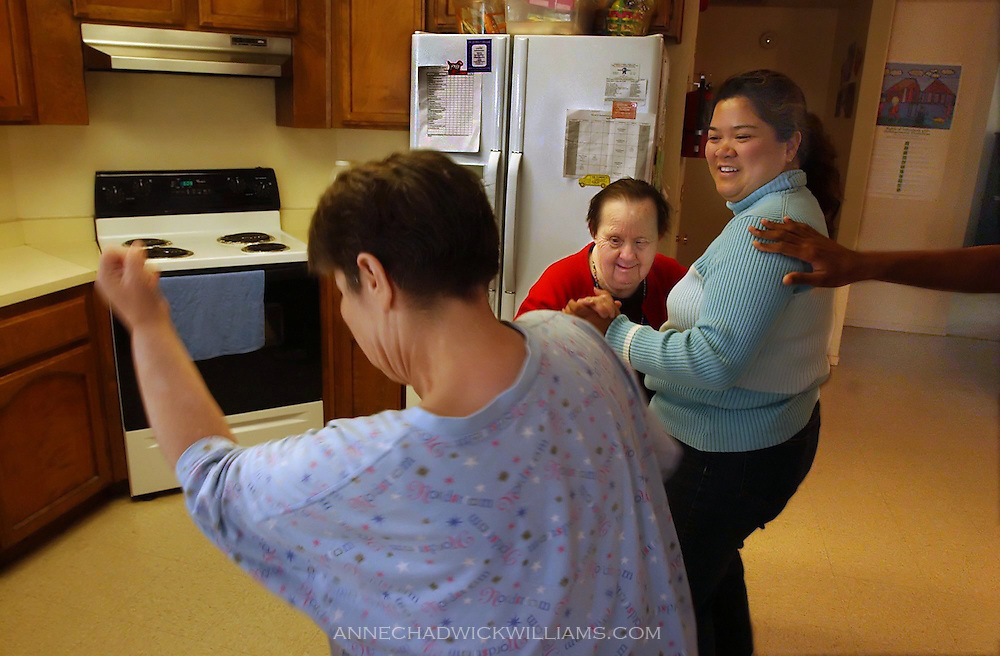 Irene Pinole dances with group home owner, Nadia Covarrubias, during an impromptu boogie in their kitchen. Anne Chadwick Williams /May  2004/ Sacramento Bee