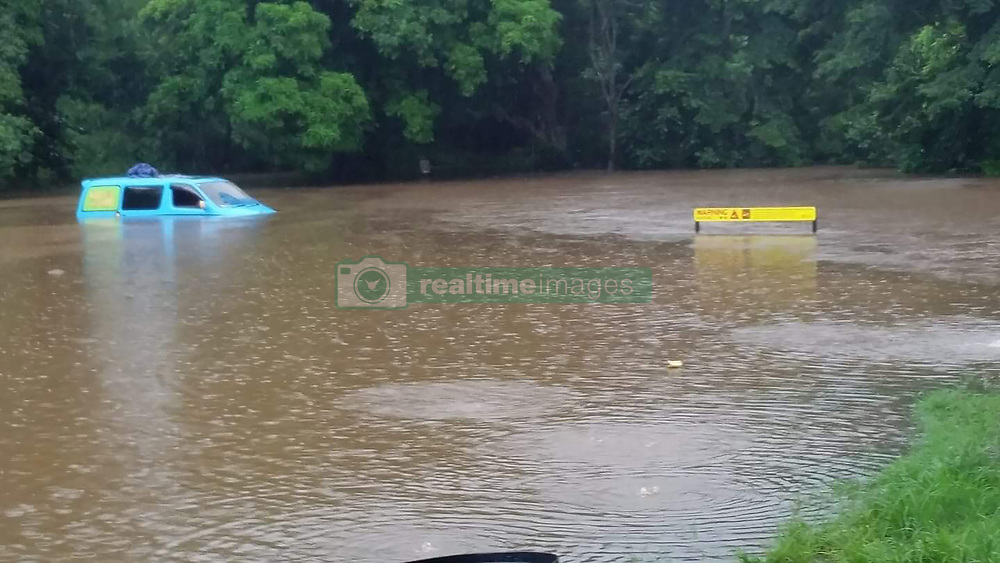 EXCLUSIVE: Pic shows Australian emergency services before they rescued three UK tourists stranded on top of their camper van. Three British backpackers had to be rescued when they woke up in their camper van to find they were surrounded by croc infested floodwater. The unhappy campers called emergency crews around 6am (local time) today (TUES) when they became flooded at Green Patch, a camping ground south of Cairns, Queensland, Australia. Officers from Queensland Fire and Emergency Services (QFES) arrived at the campsite to find three tourists – two male and one female - from the UK cowering on the roof of the Scooby-Doo-like coloured hire vehicle. It's understood the Brits feared the water could be hiding man eating saltwater crocodiles which are common in Queensland and can grow up to 16-foot long. Nearby signs indicated that the area was a crocodile warning area and locals said there were resident reptiles in the murky water. (see Magnus copy) pictures@magnusnewsagency.com +44(0)1214584402. 06 Feb 2018 Pictured: Pic from Magnus News Agency. Pic shows the camper van close to the yellow crocodile warning sign. Three British backpackers had to be rescued when they woke up in their camper van to find they were surrounded by croc infested floodwater. The unhappy campers called emergency crews around 6am (local time) today (TUES) when they became flooded at Green Patch, a camping ground south of Cairns, Queensland, Australia. Officers from Queensland Fire and Emergency Services (QFES) arrived at the campsite to find three tourists – two male and one female - from the UK cowering on the roof of the Scooby-Doo-like coloured hire vehicle. It's understood the Brits feared the water could be hiding man eating saltwater crocodiles which are common in Queensland and can grow up to 16-foot long. Nearby signs indicated that the area was a crocodile warning area and locals said there were resident reptiles in the murky water. (see Magnus copy) pictures@magnusnewsagency.