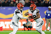 Cincinnati Bengals Quarterback Andy Dalton (14) hands off to Cincinnati Bengals Running Back Joe Mixon (28) during the International Series match between Los Angeles Rams and Cincinnati Bengals at Wembley Stadium, London, England on 27 October 2019.