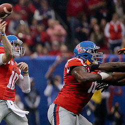 Jan 1, 2016; New Orleans, LA, USA; Mississippi Rebels quarterback Chad Kelly (10) throws a touchdown against the Oklahoma State Cowboys during the first quarter in the 2016 Sugar Bowl at the Mercedes-Benz Superdome. Mandatory Credit: Derick E. Hingle-USA TODAY Sports