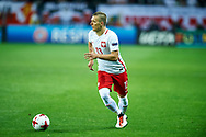 Lublin, Poland - 2017 June 16: Lukasz Moneta from Poland U21 controls the ball while Poland v Slovakia match during 2017 UEFA European Under-21 Championship at Lublin Arena on June 16, 2017 in Lublin, Poland.<br /> <br /> Mandatory credit:<br /> Photo by © Adam Nurkiewicz / Mediasport<br /> <br /> Adam Nurkiewicz declares that he has no rights to the image of people at the photographs of his authorship.<br /> <br /> Picture also available in RAW (NEF) or TIFF format on special request.<br /> <br /> Any editorial, commercial or promotional use requires written permission from the author of image.
