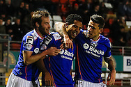 Korey Smith of Oldham Athletic (centre) celebrates scoring his team's first goal to make it 1-1 during the Sky Bet League 1 match at the Matchroom Stadium, London<br /> Picture by David Horn/Focus Images Ltd +44 7545 970036<br /> 25/03/2014