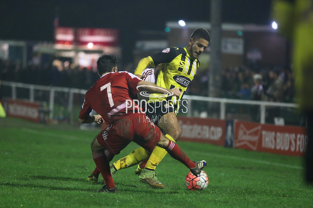 Dagenham defender Josh Passley wins the ball during the The FA Cup 2nd Round Replay match between Whitehawk FC and Dagenham and Redbridge at the Enclosed Ground, Whitehawk, United Kingdom on 16 December 2015. Photo by Phil Duncan.