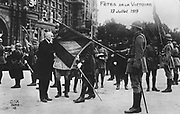 World War I 1914-1918:  French victory celebrations 13-14 July 1919 - kissing the tricoleur.  Paris, France, Flag, Patriotism