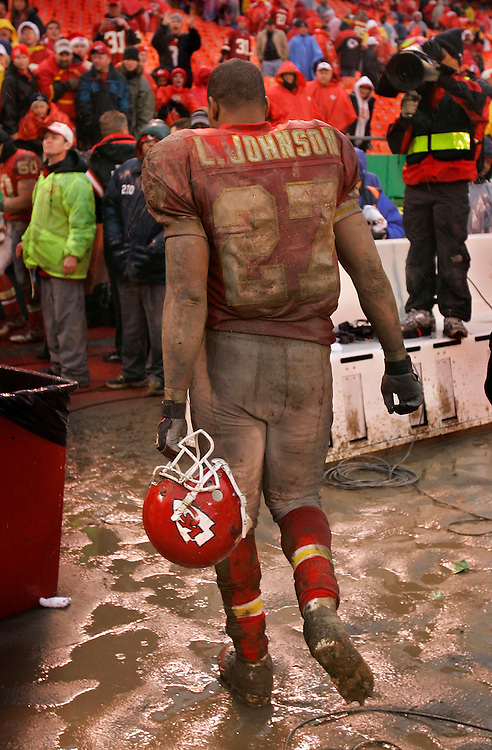 Kansas City Chiefs running back Larry Johnson walked off the Arrowhead field, covered in mud from Sunday's rain, after the Chiefs beat the San Diego Chargers 20-7, on December 24, 2005, at Arrowhead Stadium.