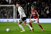 Hayden Coulson (33) of Middlesbrough looks to challenge Tom Cairney (10) of Fulham during the EFL Sky Bet Championship match between Fulham and Middlesbrough at Craven Cottage, London, England on 17 January 2020.