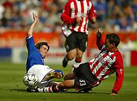 Photo Aidan Ellis.<br />Leicester City v Southampton (FA Barclaycard Premiership) 16/08/2003.<br />Leicester's Muzzy Izzett and Southampton's Paul Telfer.