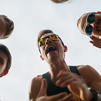 Adam Strueby leads a pre-race huddle before the start of the annual Cougar Trot on September 17 at Douglas Park. Credit: Arthur Ward/Arthur Images