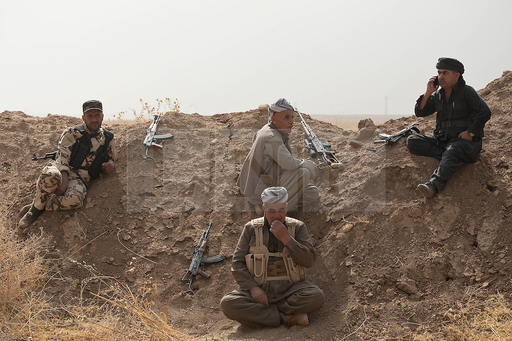 20/10/2016. Bashiqa, Iraq. Kurdish peshmerga rest after taking up defensive positions along an Islamic State constructed berm during an offensive to retake the ISIS held town of Bashiqa, near Mosul, Iraq today (20/10/2016).<br /> <br /> Launched in the early hours of today with support from coalition special forces and air strikes, the attack is part of the larger operation to retake Mosul from the Islamic State, and involves both the Kurds and the Iraqi Army. The city of Bashiqa, around 9 miles north of Mosul, is one of several gateway areas that must be taken before any attempted offensive on Mosul itself.<br /> <br /> Despite the peshmerga suffering several casualties after militants fought back using mortars, heavy machine guns and snipers, the Kurdish forces were quickly taking ground with Haider al-Abadi, the Iraqi prime minister, stating that the operation to retake Mosul was progressing faster than expected. Photo credit: Matt Cetti-Roberts/LNP
