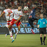 Paris St. Germain's Jean Kevin Augustin (right) battles for the ball with SL Benfica's Andre Almeida (middle) and Andres Samaris in the International Champions Cup in Toronto.