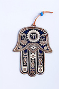 Studio shot of a decorated silver Hamsa amulet