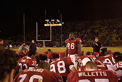 Stanford football vs Notre Dame. Last game at stadium before renovation. Stanford loses 38-31. ..Nose tackle, Babatunde Oshinowo (#96) leads a group prayer after the game.