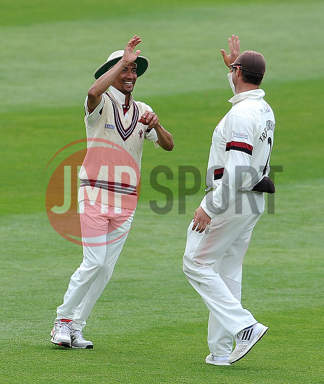 Somerset's Alfonso Thomas and Marcus Trescothick celebrate the wicket of Yorkshire's Adil Rashid. Photo mandatory by-line: Harry Trump/JMP - Mobile: 07966 386802 - 27/05/15 - SPORT - CRICKET - LVCC County Championship - Division 1 - Day 4 - Somerset v Yorkshire - The County Ground, Taunton, England.