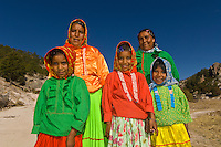 Tarahumara Indian women and girls wearing their colorful native costumes, Ejido San Alonso, Copper Canyon, Mexico