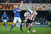 Eastleigh Forward, James Constable (9) and Brentford Midfielder, Ryan Woods (15) during the The FA Cup 3rd round match between Brentford and Eastleigh at Griffin Park, London, England on 7 January 2017. Photo by Adam Rivers.