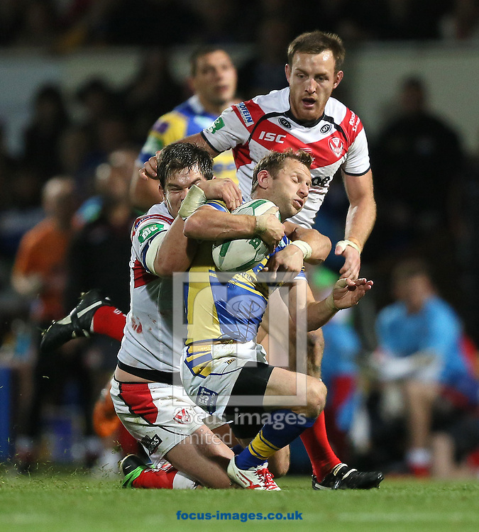 Picture by Paul Gaythorpe/Focus Images Ltd +447771 871632<br /> 20/09/2013<br /> Louie McCarthy Scarsbrook of Saint Helens tackles Rob Burrow of Leeds Rhinos during the Super League match at Headingley Carnegie Stadium, Leeds.