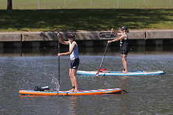 © Licensed to London News Pictures. 25/05/2020. Windsor, UK. Paddle boarders take to the River Thames near Windsor Castle as the Bank Holiday weather brings high temperatures and sunshine. The government has announced a series of measures to slowly ease lockdown, which was introduced to fight the spread of the COVID-19 strain of coronavirus. Photo credit: Peter Macdiarmid/LNP