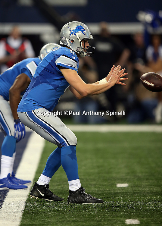 Detroit Lions quarterback Matthew Stafford (9) catches a shotgun snap near his own end zone during the NFL week 18 NFC Wild Card postseason football game against the Dallas Cowboys on Sunday, Jan. 4, 2015 in Arlington, Texas. The Cowboys won the game 24-20. ©Paul Anthony Spinelli