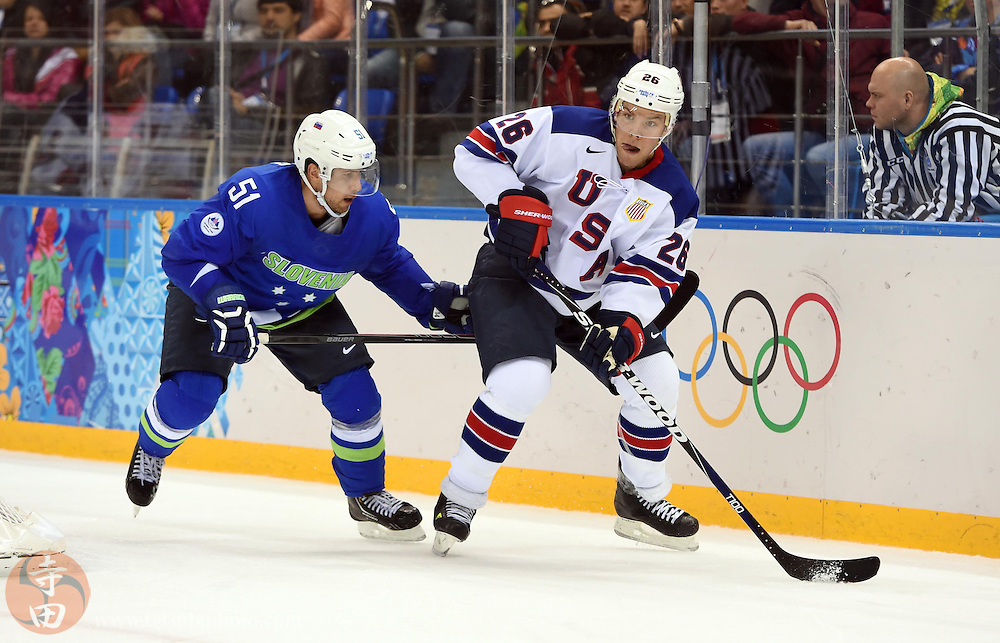 Feb 16, 2014; Sochi, RUSSIA; USA forward Paul Stastny (26) controls the puck ahead of Slovenia defenseman Mitja Robar (51) in a men's ice hockey preliminary round game during the Sochi 2014 Olympic Winter Games at Shayba Arena.