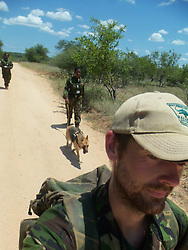 July 7, 2015 - BALULE RESERVE, SOUTH AFRICA: Commander Russel leads the dog patrol. LED BY BRITISH former military personnel these pictures show how courageous women anti-poachers train with guns in their battle to preserve Africa's endangered animals. Operating in the Kruger National Park's Balule Nature Reserve the 24-member strong all-female Black Mamba Anti-Poaching Unit patrols 50,000 hectares of bush to protect elephants and rhinos that are hunted as part of the estimated £12billion a year illegal world animal trade. These ladies, who as pictures show pose with weapons but also know how to party, are on the front line of a deadly war for the resources of their continent. Over the past year 1,000 wildlife rangers have been killed in Africa while protecting endangered wildlife. Black Mamba Commander and former Royal Navy serviceman Russell Baker (28) from Grimsby, UK explained exclusively how and why this South African special unit was established. (Credit Image: © Media Drum World/MediaDrumWorld/ZUMAPRESS.com)