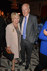 JUDITH CHALMERS and NEIL DURDEN-SMITH at the Veuve Clicquot Business Woman Award 2016 held at Claridge's Hotel, Brook Street, London on 9th May 2016.