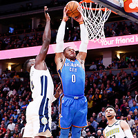 09 November 2017: Oklahoma City Thunder guard Russell Westbrook (0) goes for the dunk past Denver Nuggets forward Paul Millsap (4) during the Denver Nuggets 102-94 victory over the Oklahoma City Thunder, at the Pepsi Center, Denver, Colorado, USA.