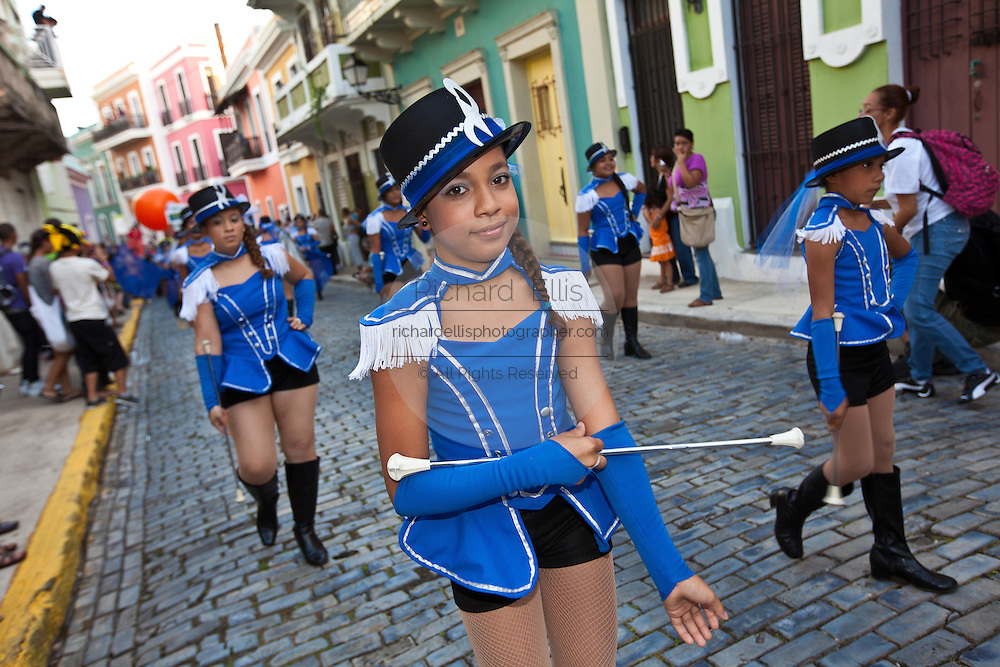 A young majorette parades at the Festival of San Sebastian in San Juan, Puerto Rico.