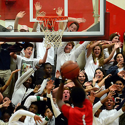 Pasadena fans try to distract Burroughs' Tristen Hull (1) during a free-throw in the first half of a prep basketball game at Pasadena High School in Pasadena, Calif., on Friday, January 29, 2016.